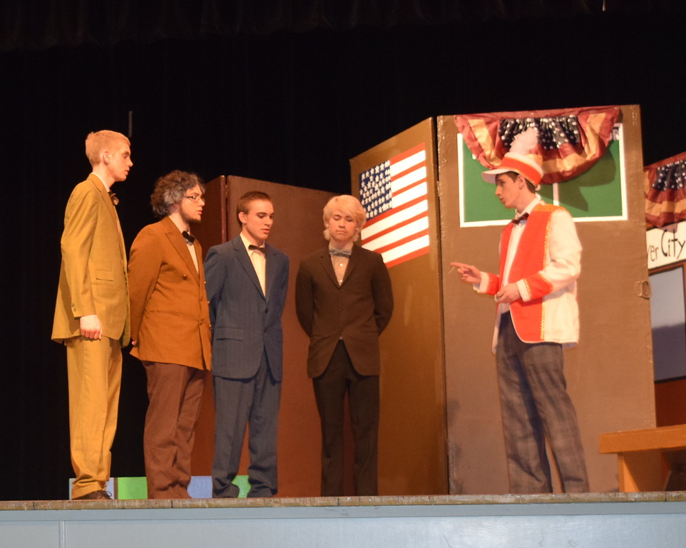 "Harold Hill (Clifford Farrington), right, talks with Olin Britt (Richard Tomlinson), second from right, Ewart Dunlop (Chris Scott), second from left, Oliver Hix (Tyler Parks), left, and Jacey Squires (Gabrielle Deleon), during a rehearsal for Sterling HIgh School's ""The Music Man."""