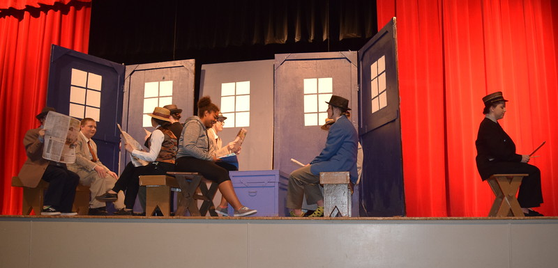 "Passengers on a train make their way to River City, Iowa in a scene from Sterling High School's production of ""The Music Man."""