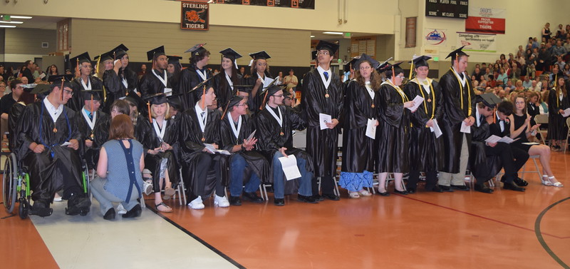 Scholarship recipients stand to be recognized during Sterling High School's Commencement Exercises Saturday, May 28, 2016.