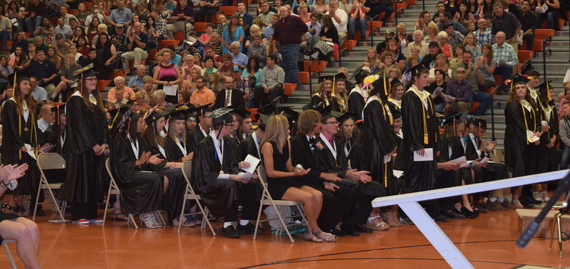 National Honor Society members stand to be recognized during Sterling High School's Commencement Exercises Saturday, May 28, 2016.