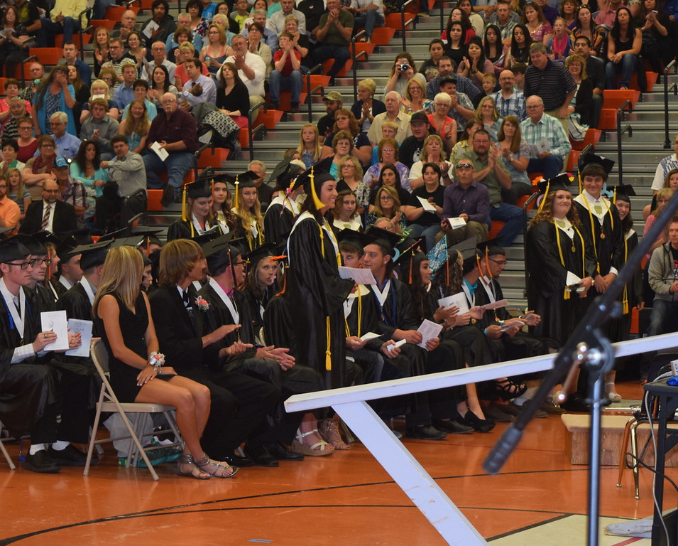 Graduates with honors certification stand to be recognized during Sterling High School's Commencement Exercises Saturday, May 28, 2016.