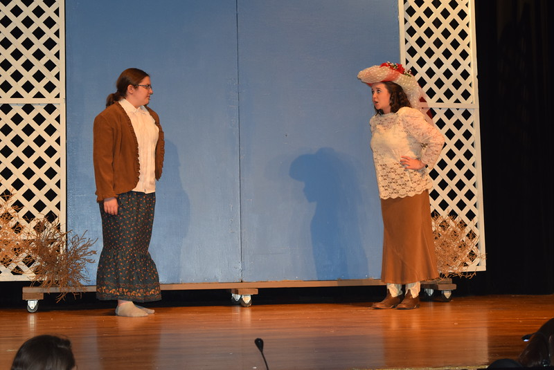 "Winnie Tate (Camryn Trump) and Dolly Tate (Grace Reeves) have a conversation in a scene from Sterling High School's upcoming production of ""Annie Get Your Gun."""