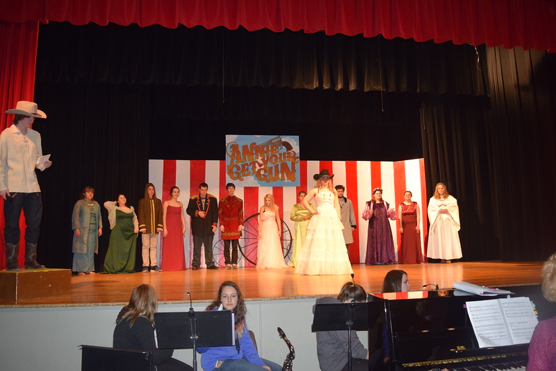 "Buffalo Bill Cody (Clifford Farrington) welcomes European royalty to the Wild West Show, starring Annie Oakley (Kori Penfold), in a scene from Sterling High School's upcoming production of ""Annie Get Your Gun."""