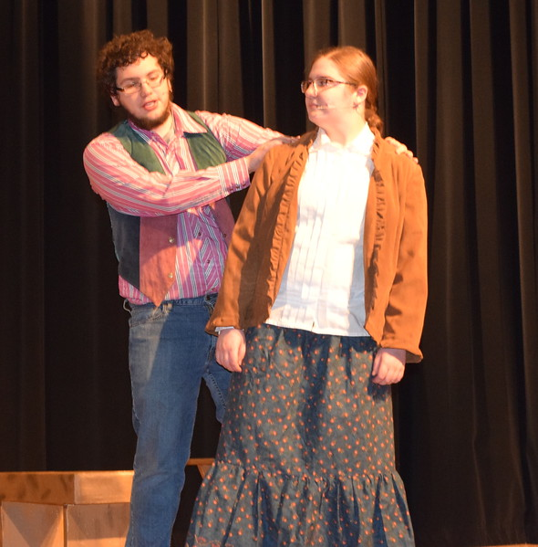 "Tommy Keeler (Christian Scott), a knife-thrower in Buffalo Bill Cody's Wild West Show, and his girlfriend Winnie Tate (Camryn Trump) perform ""I'll Share It All With You"" in a scene from Sterling High School's upcoming production of ""Annie Get Your Gun."""