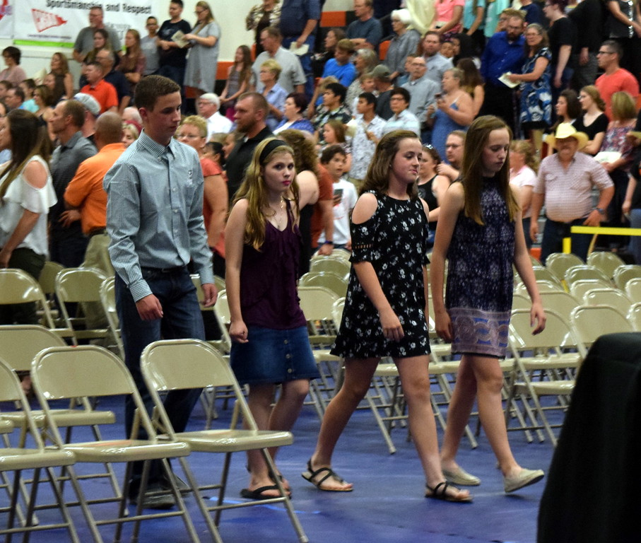 . Sterling Middle School eighth graders proceed into the Wally Post Gym at Sterling High School during continuation night Thursday, May 24, 2018.