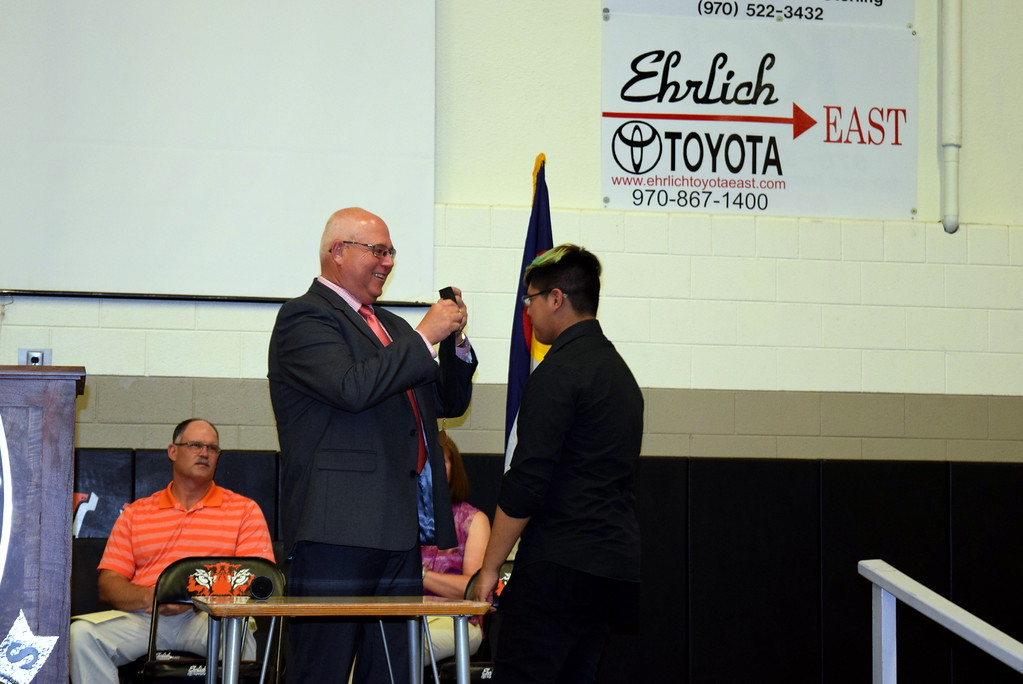 . Sterling Middle School Principal Bob Hall presents the Most Improved Student Award to Deangelo Molina during the school\'s Continuation Night celebration Thursday, May 24, 2018.
