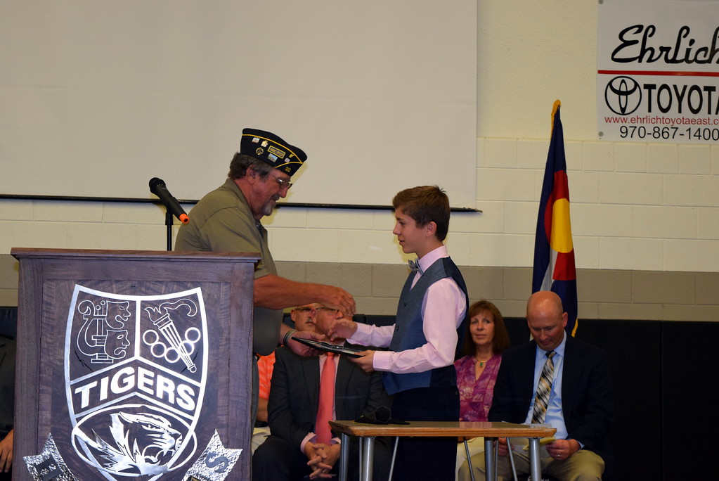 . ave Conley, finance officer for American Legion Sterling Post No. 20, presents the Outstanding Boy Award to Jace Wright during Sterling Middle School\'s Continuation Night celebration Thursday, May 24, 2018.
