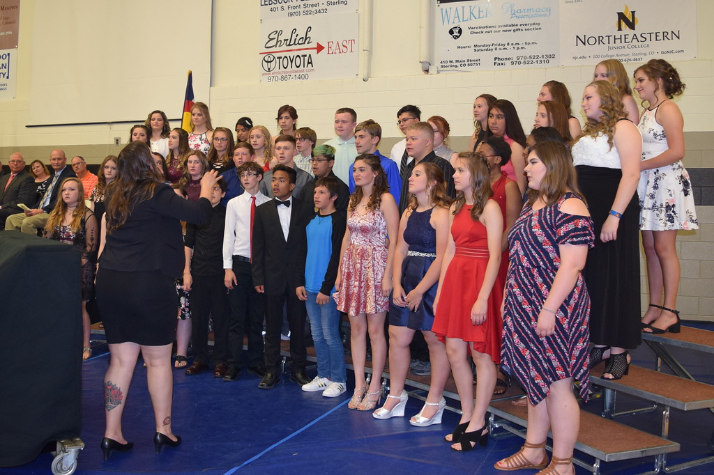 ". The Sterling MIddle School eighth grade choir performs ""Home\"" under the direction of Michelle White, during the school\'s Continuation Night celebration Thursday, May 24, 2018."