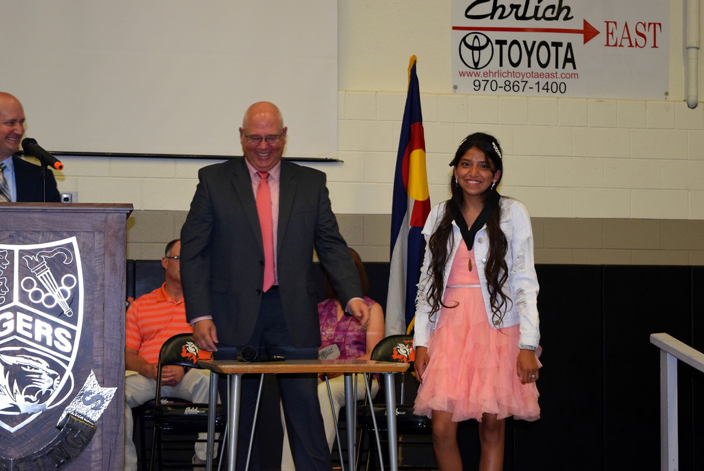 . Sterling Middle School Principal Bob Hall presents the Most Improved Student Award to Precious Precious Jasso during the school\'s Continuation Night celebration Thursday, May 24, 2018.