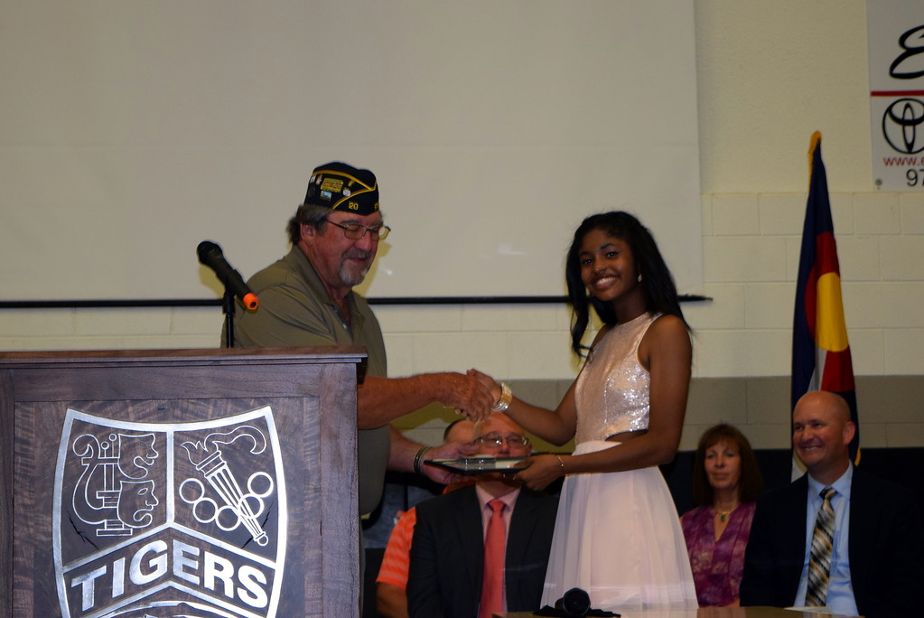 . Dave Conley, finance officer for American Legion Sterling Post No. 20, presents the Outstanding Girl Award to Emerie Rios during Sterling Middle School\'s Continuation Night celebration Thursday, May 24, 2018.