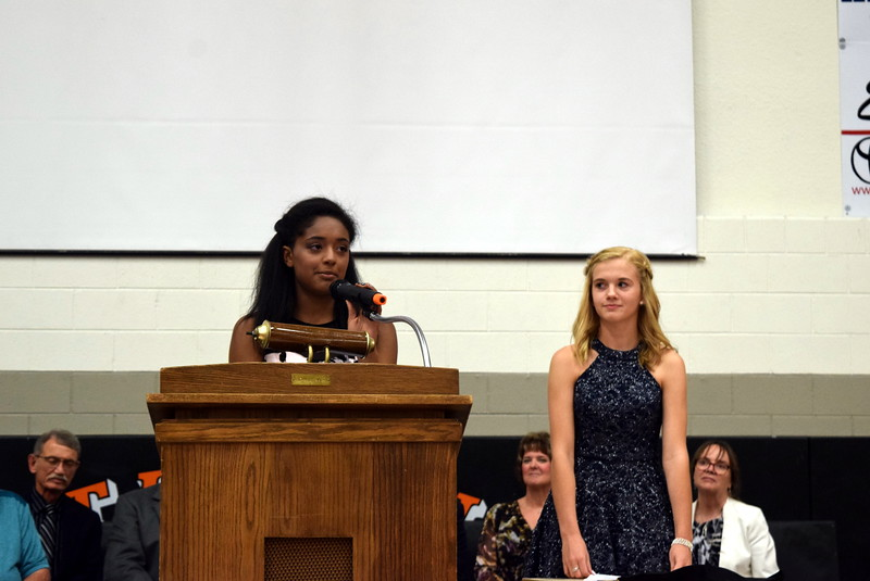 Sterling Middle School Co-Student Council Presidents Jaden Newson, left, and Hailey Fehringer give welcoming remarks at the school's Continuation Night Tuesday, May 23, 2017.
