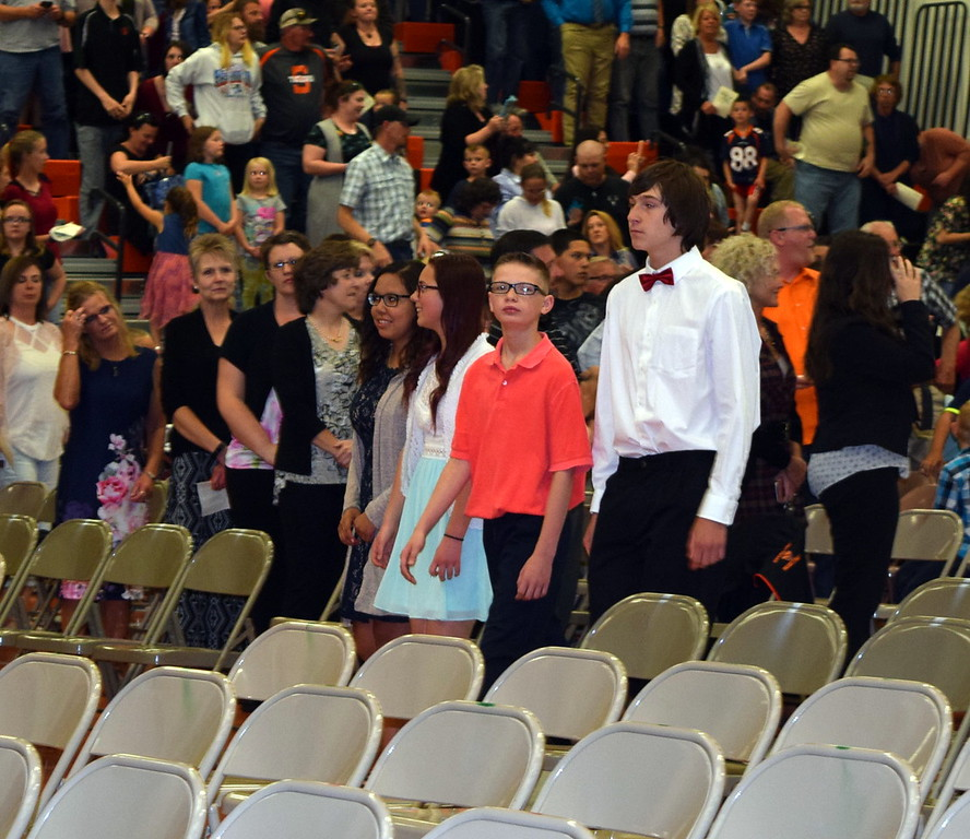 Sterling Middle School eighth graders walk in to Wally Post Gym at Sterling High School at the start of the school's Continuation Night Tuesday, May 23, 2017.