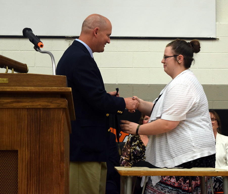 Mike Holloway, dean of students, presents the Most Improved Student Award to Kahylani Langridge at Sterling Middle School's Continuation Night Tuesday, May 23, 2017.