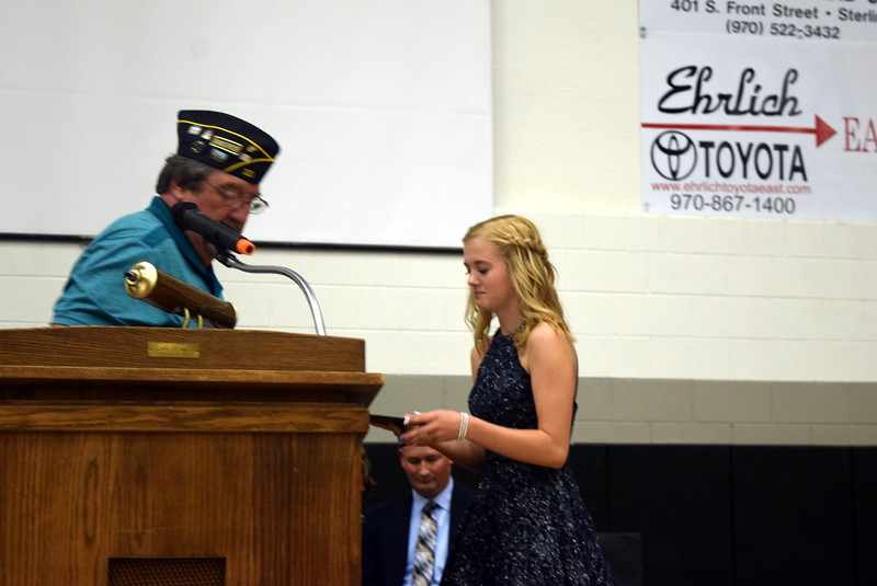 Hailey Fehringer receives the Outstanding Girl Award from Dave Conley, finance officer with American Legion Sterling Post No. 20, at Sterling Middle School's Continuation Night Tuesday, May 23, 2017.