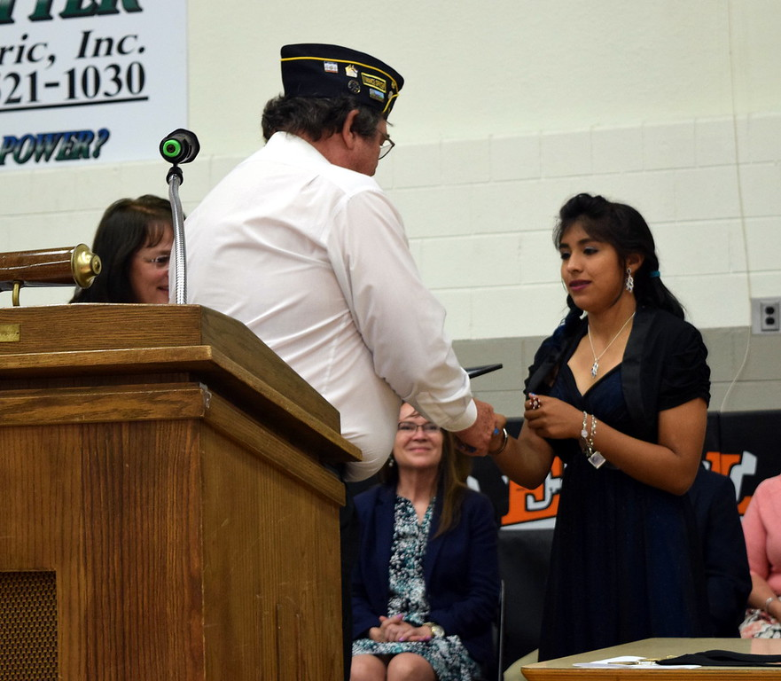 Dave Conley, with the Sterling American Legion, presents the Outstanding Girl Award to Joslyne Lopez at Sterling Middle School's Continuation Night Tuesday, May 24, 2016.