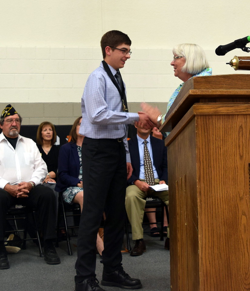 Anne Sellers, counselor at Sterling Middle School, presents the Most Improved Student Award to Jayce Maker at the school's Continuation Night Tuesday, May 24, 2016.