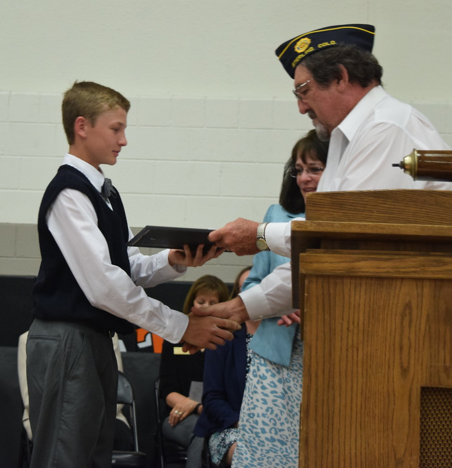 Dave Conley, with the Sterling American Legion, presents the Outstanding Boy Award to Chase Hume at Sterling Middle School's Continuation Night Tuesday, May 24, 2016.