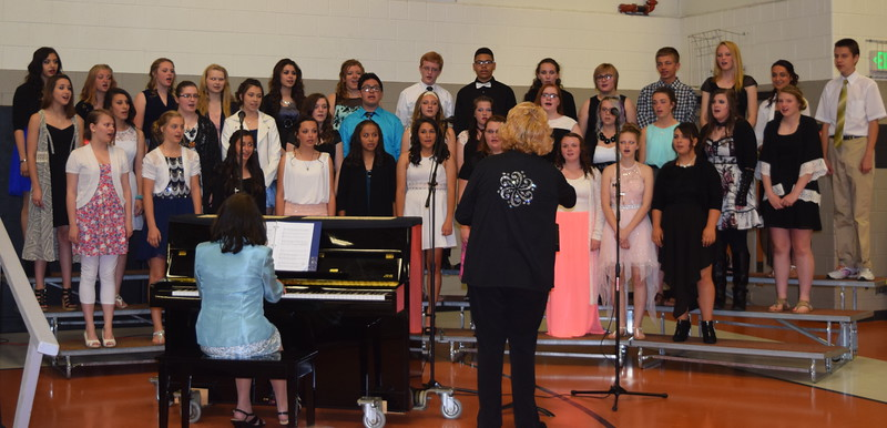 "The eighth grade choir performs ""The Power of One,"" under the direction of Annette Lambrecht, at Sterling Middle School's Continuation Night Tuesday, May 24, 2016."