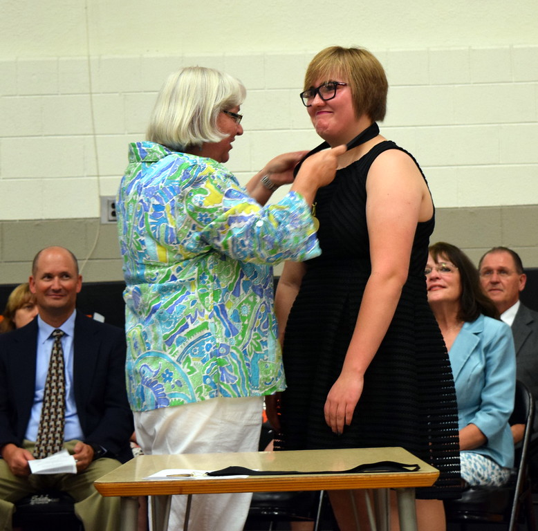 Anne Sellers, counselor at Sterling Middle School, presents the Most Improved Student Award to Carley Schadegg at the school's Continuation Night Tuesday, May 24, 2016.