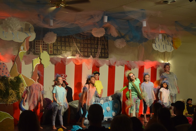 "Jojo's (Stayci Belcha)  imagination brings to life a sea of Fish (Ameilia Hupke, Gabby Manly, Derek McMinn, Paige McCauley, Paiten Neilsen, Keira Milton, Amelia Rios and Karly McKinny) in a scene from Sterling Miracle Players Kids Camp's produciton of ""Seussical Jr."" Saturday, July 22, 2017."