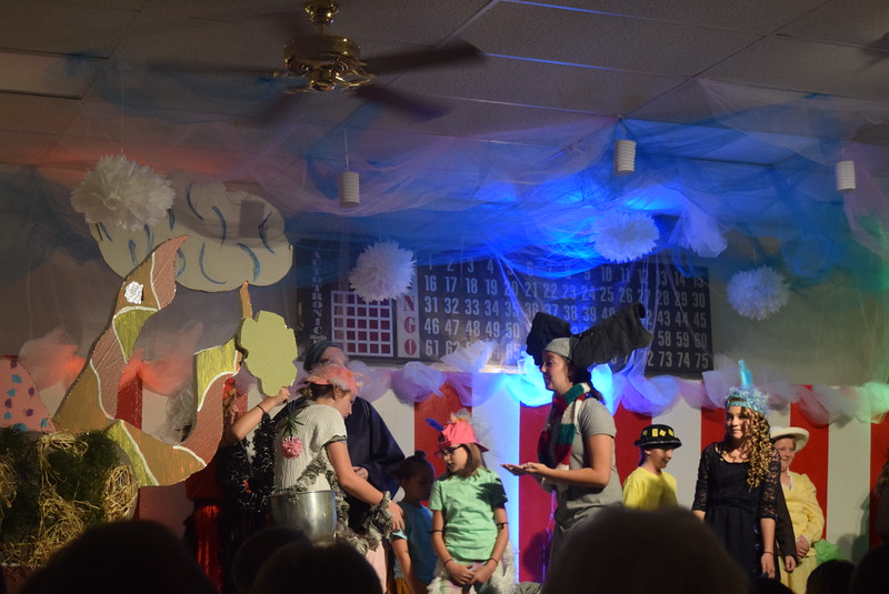 """Mayzie (Mikayla Von Steinman) threatens to burn Horton's (Madison Trahern) flower in a boiling pot in a scene from Sterling Miracle Players Kids Camp's produciton of """"Seussical Jr."""" Saturday, July 22, 2017."""
