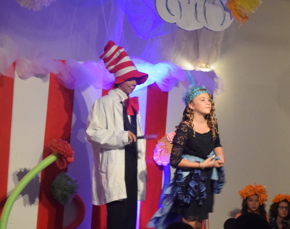 """The Cat in the Hat (Tristan Trahern) helps Gertrude McFuzz (Grace Graham) cut off her long tail in a scene from Sterling Miracle Players Kids Camp's produciton of """"Seussical Jr."""" Saturday, July 22, 2017."""