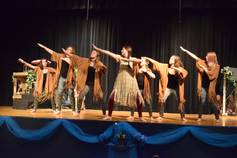 "Tiger Lily (Katherin Von Steinman) leads her fellow tribe members (Taylor Cranwell, Regan Wright, Elizabeth Crandell, Karly McKinney, Jaden Penfold and Mikayla Von Steinman) in a dance in a scene from Sterling Miracle Players' upcoming production of ""Peter Pan."""