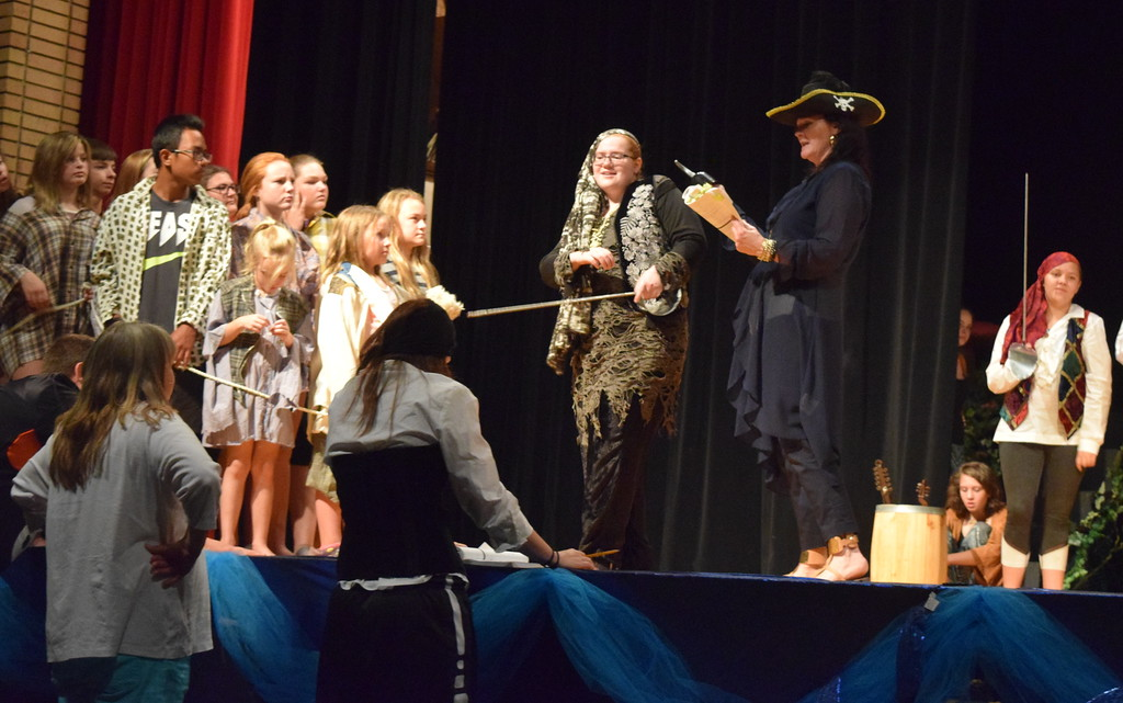 ". Captain Hookl (EJ Wright) threatens to make the Lost Boys and the Darling children walk the plank in a scene from Sterling Miracle Players\' upcoming production of ""Peter Pan.\"""