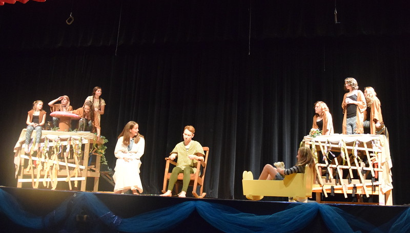 "Peter Pan (Scott Glissmann) and Wendy (Madison Trahern) have a conversation as Tiger Lily (Katherine Von Steinman) and her tribe keep watch over the fort in a scene from Sterling Miracle Players' upcoming production of ""Peter Pan."""