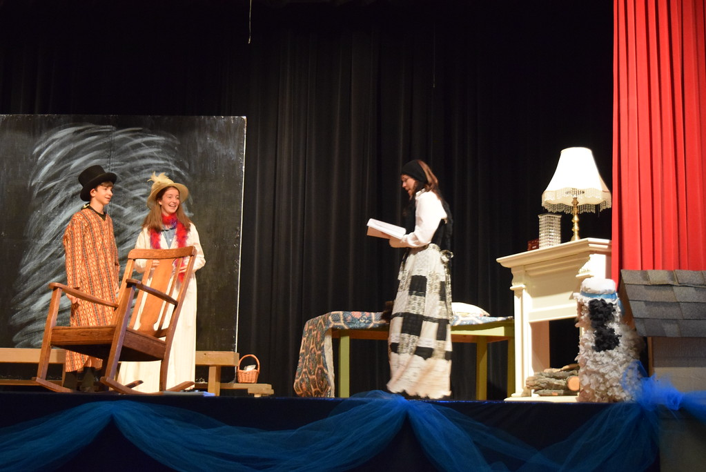 ". Liza the Maid (Jaci Yula) talks with Wendy Darling (Madison Trahern) and John Darling (Tristan Trahern) as Nana (MaKenna Rye) looks on from her dog house in a scene from Sterling Miracle Players\' upcoming production of ""Peter Pan.\"""