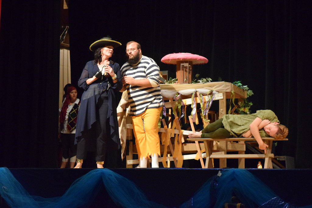 ". Captain Hook (EJ Wright) has a conversation with her henchman Smee (Jacob Reyes) while Peter Pan (Scott Glissmann) sleeps in a scene from Sterling Miracle Players\' upcoming production of ""Peter Pan.\"""