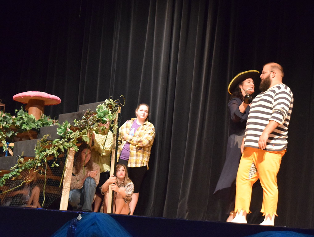 ". The Lost Boys hide from Captain Hook (EJ Wright) as she threatens her henchman Smee (Jacob Reyes) in a scene from Sterling Miracle Players\' upcoming production of ""Peter Pan.\"""