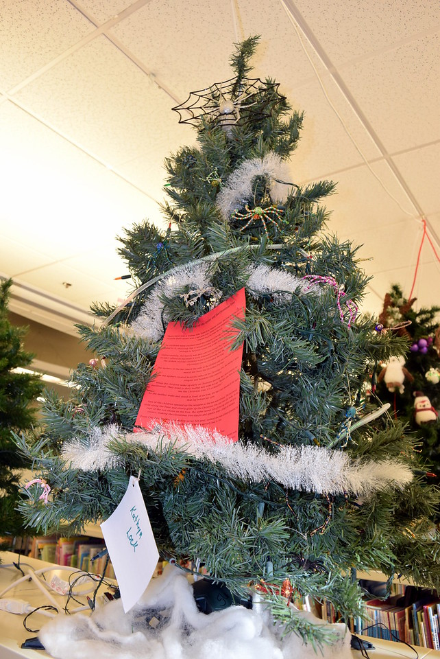 "A Christmas tree decorated by Kathryn Lock, for Sterling Public Library's Parade of trees, tells ""The Story of the Spider and the Christmas Tree."""