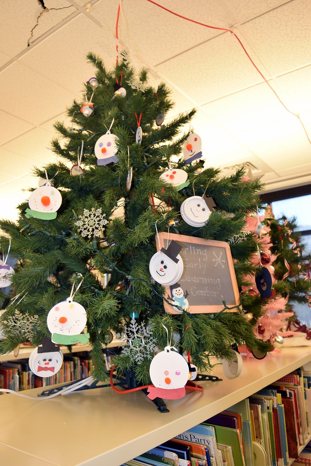 Sterling Early Learning Center's tree in Sterling Public Library's Parade of Trees is filled with handcrafted snowman ornaments.