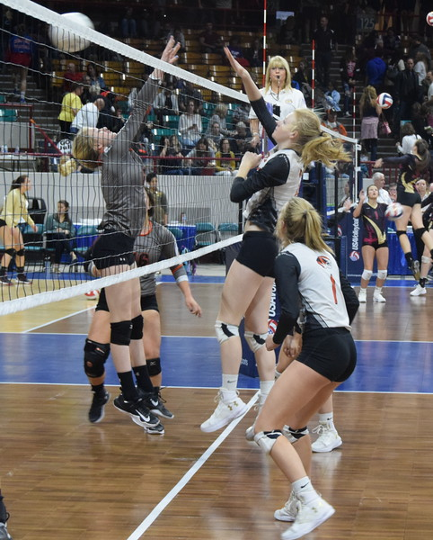 Lauryn Luft scores a kill after hitting the ball past a Lutheran blocker.