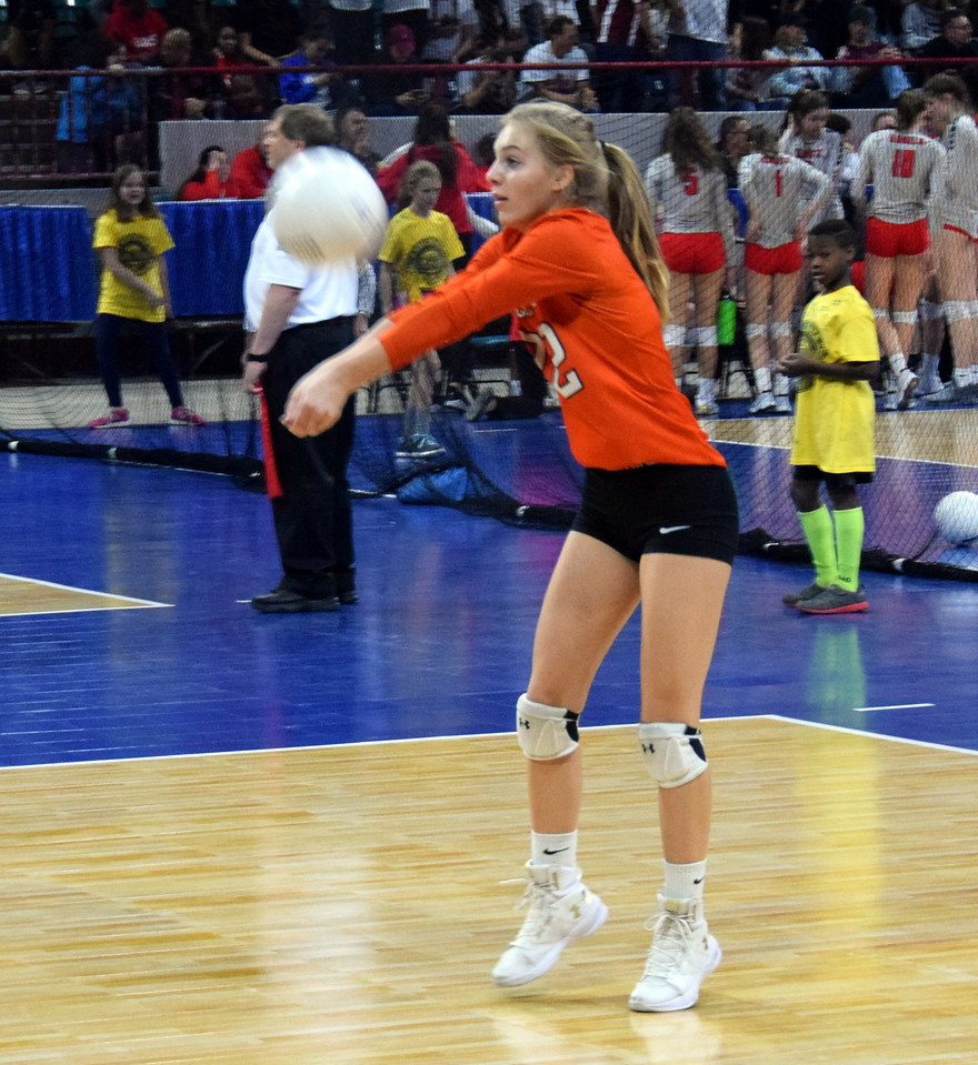 Jade Feather receives a serve during pool play at the Denver Coliseum.