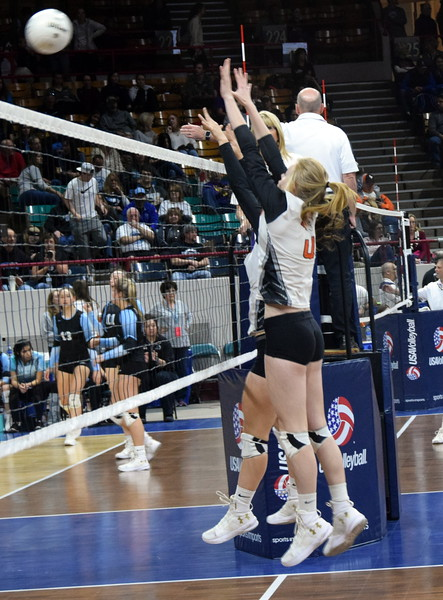 Lauryn Luft goes up for a block on Saturday at the Denver Coliseum.
