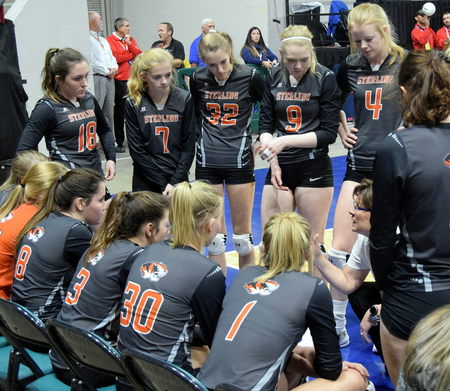 Coach Lisa Schumacher instructs the players during a timeout.