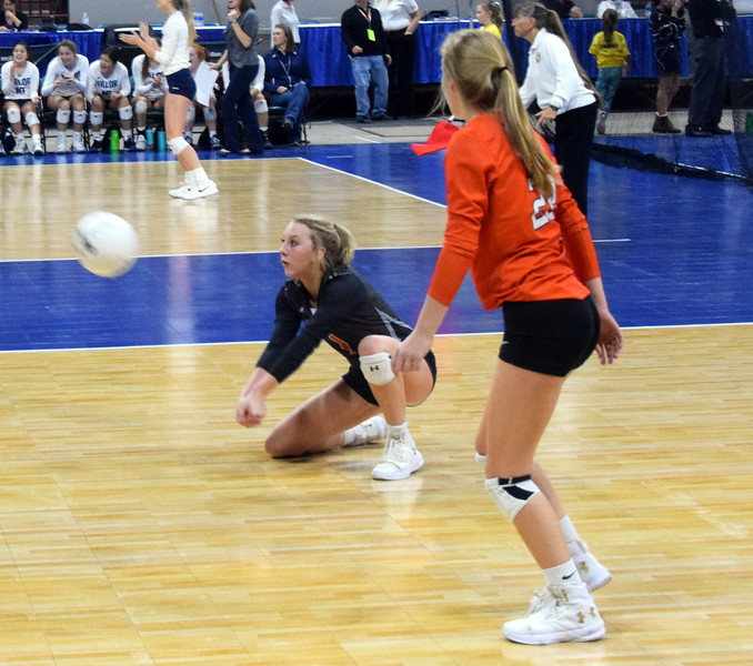 Kyndall Feather gets low to keep a ball from hitting the court on Saturday at the Denver Coliseum.