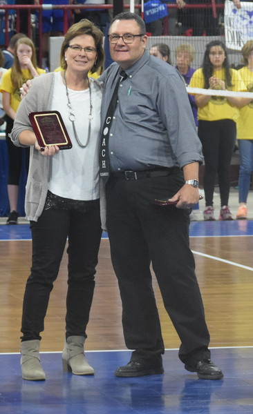 Coach Lisa Schumacher, pictured with Fleming coach Doug Kamery.  Schumacher was honored before the championship game by CHSAA for reaching the 400 win milestone.