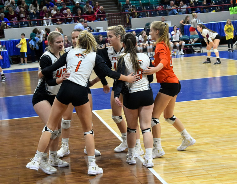 The Sterling Tigers come together after scoring a point.
