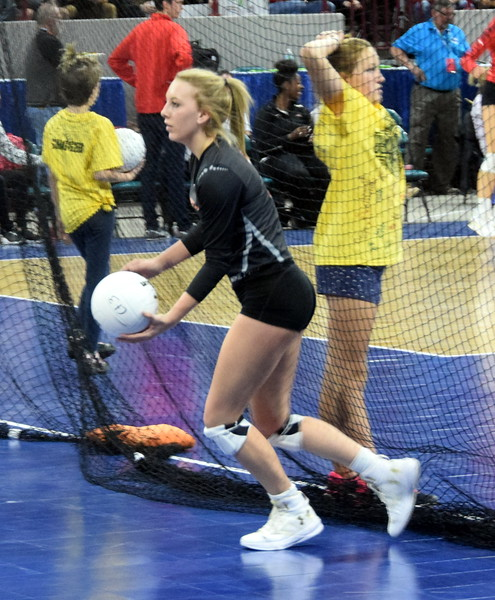 Kyndall Feather lines up for a serve during pool play of the 3A state tournament.