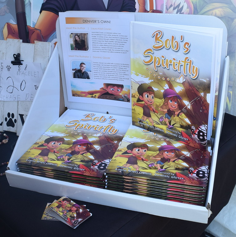 """Copies of the book """"Bob's Spiritfly,"""" written by Sterling High School graduate Laura Kristi Cronin and illustrated by Dominic Glover, also formerly of Sterling, were available at Sugar Beet Days Sunday, Sept. 16, 2017. The book tackles the very sensitive subject of losing a pet with poetic grace and inspiring illustrations."""