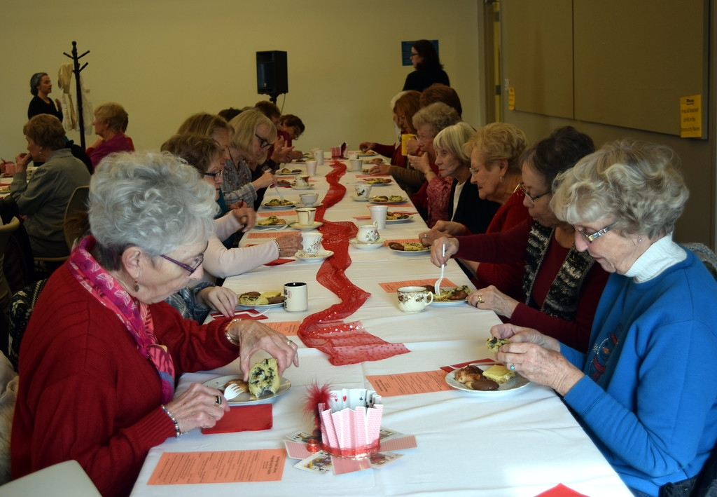 . Guests enjoy some delicious treats along with their tea at Sterling Public Library\'s annual Valentine\'s Tea Friday, Feb. 8, 2019.