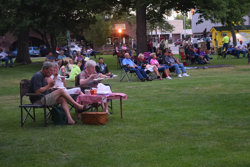 Concertgoers enjoy a meal as they listen to the music of the Wendy Woo Band at the Transwest Concerts on the Green...July Jamz, Friday, July 8, 2016.
