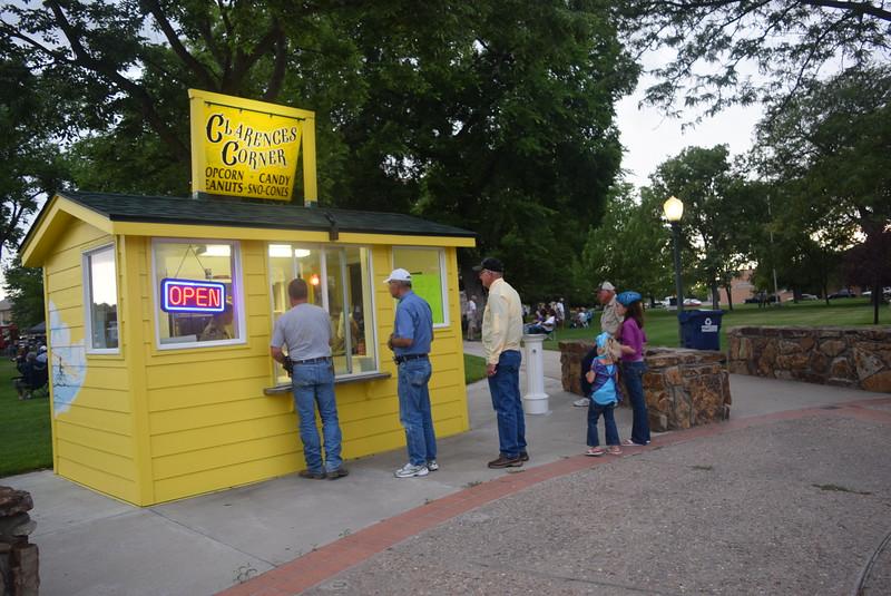 Concertgoers line up at Clarences Corner to get some popcorn during July Jamz Friday, July 8, 2016.