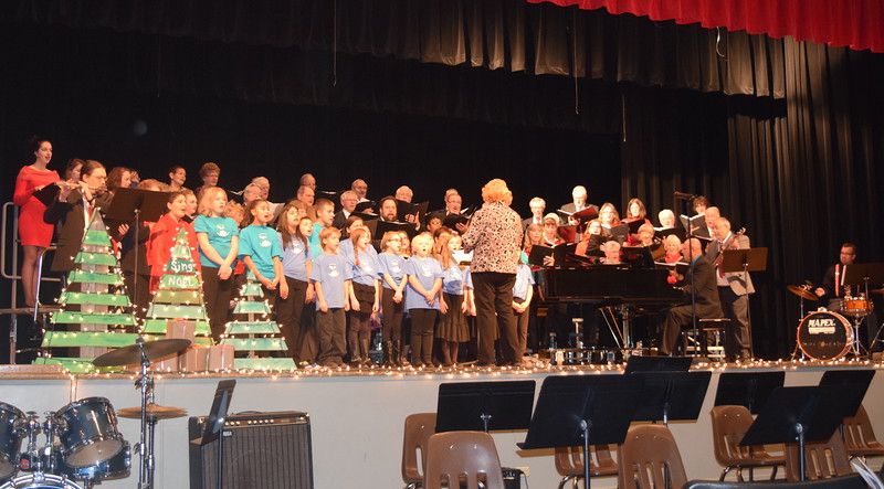 "Windsong Chorus, Centennial State Chorus and the RE-1 Valley Children's Chorale perform ""Sing Noel,"" under the direction of Annette Lambrecht, and accompanied by Darren  Luft, piano; Rick Fleharty, bass guitar; Lee Lippstrew, precussion; and Joseph Greve, flute; during the choruses ""Sing Noel at Christmas"" benefit concert Sunday, Dec. 4, 2016."