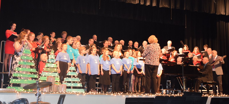 "The Windsong Chorus, Centennial State Chorus and RE-1 Valley Children's Chorale perform ""Silent Night,""  under the direction of Annette Lambrecht, and accompanied by Camryn Trump, flute; Darren Luft, piano; and Rick Fleharty, bass guitar, at the ""Sing Noel at Christmas"" benefit concert, Sunday, Dec. 4, 2016."