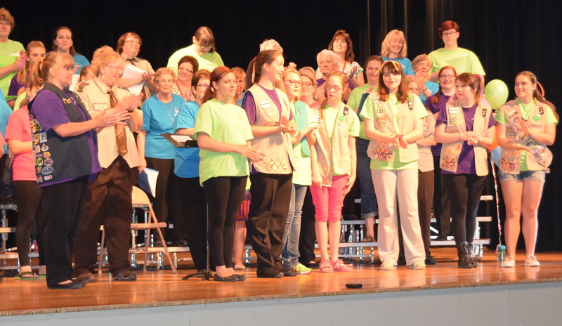 Girl Scouts who participated in Windsong Chorus' Barbershop Festival and Show Saturday, June 4, 2016, were able to earn an activity badge based on the number of years they've participated in the event. Earning their two-year starts this year were, from left; Desiny Boden, Madison Trahern, Karly McKinney, Angel Trussell, Samantha Matson, April Martin and Cyntera May. Joining them on stage are troop leader Dana May and Windsong Chorus member Chris Wolf, who presented the stars. The girls were introduced to four-part harmony in the barbershop style, given tips about how to emcee, costumining and makeup, and provided an opportunity to experience the thrill of performing for an audience.