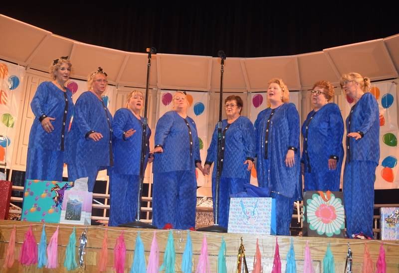 "KC Connection and Smile! Quartets – Ce Merrigan, Chris Wolf, Earleen Friedly, Mary Ann Anderson, Carol Ross, Anette Lambrecht, Colleen Gardner and Lisa Atkins – perform during Windsong Chorus' ""Pajama-Rama"" fall show Sunday, Oct. 16, 2016."